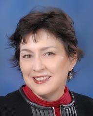 A headshot of Tracy Stewart