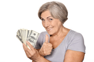 canstockphoto22439542 happy older woman with dollars