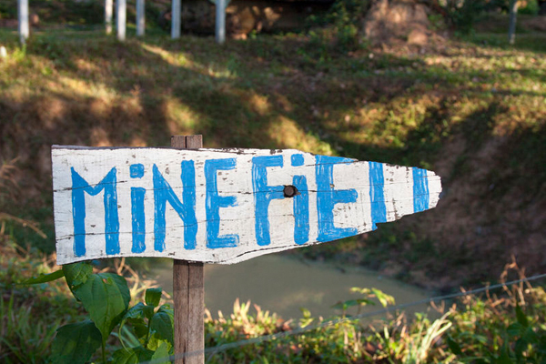 A wooden sign stating 'Minefield'.