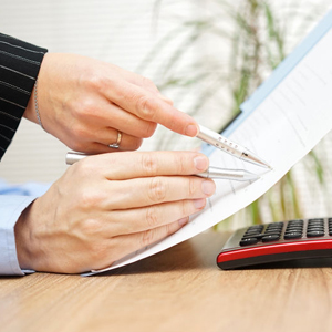 A divorce CPA and client examine financial documents.
